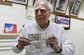 500 रुपए के दो तरह के नोटों पर राज्यसभा में हंगामा