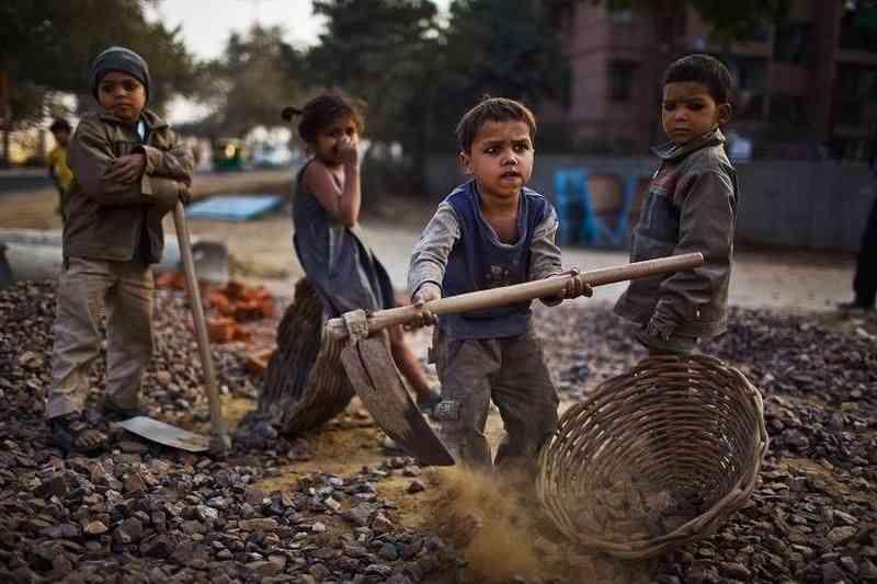 kids doing child labor on shops