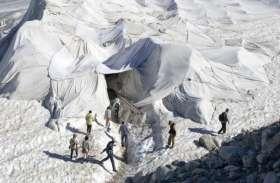 स्विट्जरलैंड: रोन ग्लेशियर को बचाने की कवायद, पिघलने से रोकने के लिए सफेद कम्बलों से ढंका गया