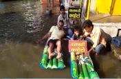 सपा नेता ने सड़क पर बहते सीवर के पानी को बनाया स्विमिंग पूल, कहा यह है पीएम मोदी का क्योटो