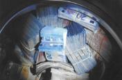 वॉशिंग मशीन में छुपाए तीन करोड़, पुलिस ने दर्ज किया मनी लांडरिंग का मुकदमा