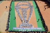विश्व कप ट्रॉफी के आकार में किया योग