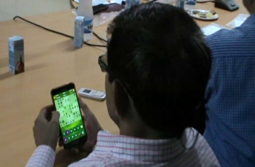 Officer Buisy in Mobile Game during DM Meeting with Lekhpal