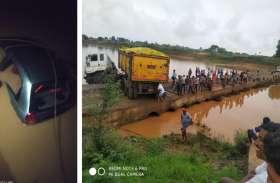 ट्रेलर की टक्कर से कार समेत नदी में जा गिरा युवक, रपटा पर ट्रेलर फंसने से 18 घंटे तक लगी रही वाहनों की लाइन