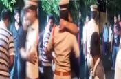 जुलूस में नाचते हुए युवक ने जबरन पुलिस अफसर को चूमा, वीडियो हो रहा जमकर वायरल