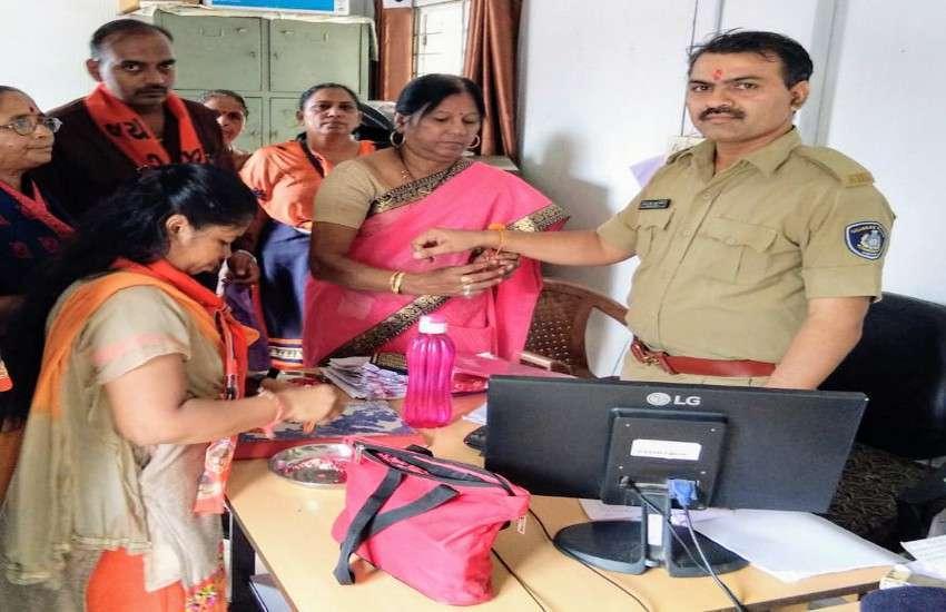 Rakhi tied to policemen in police stations