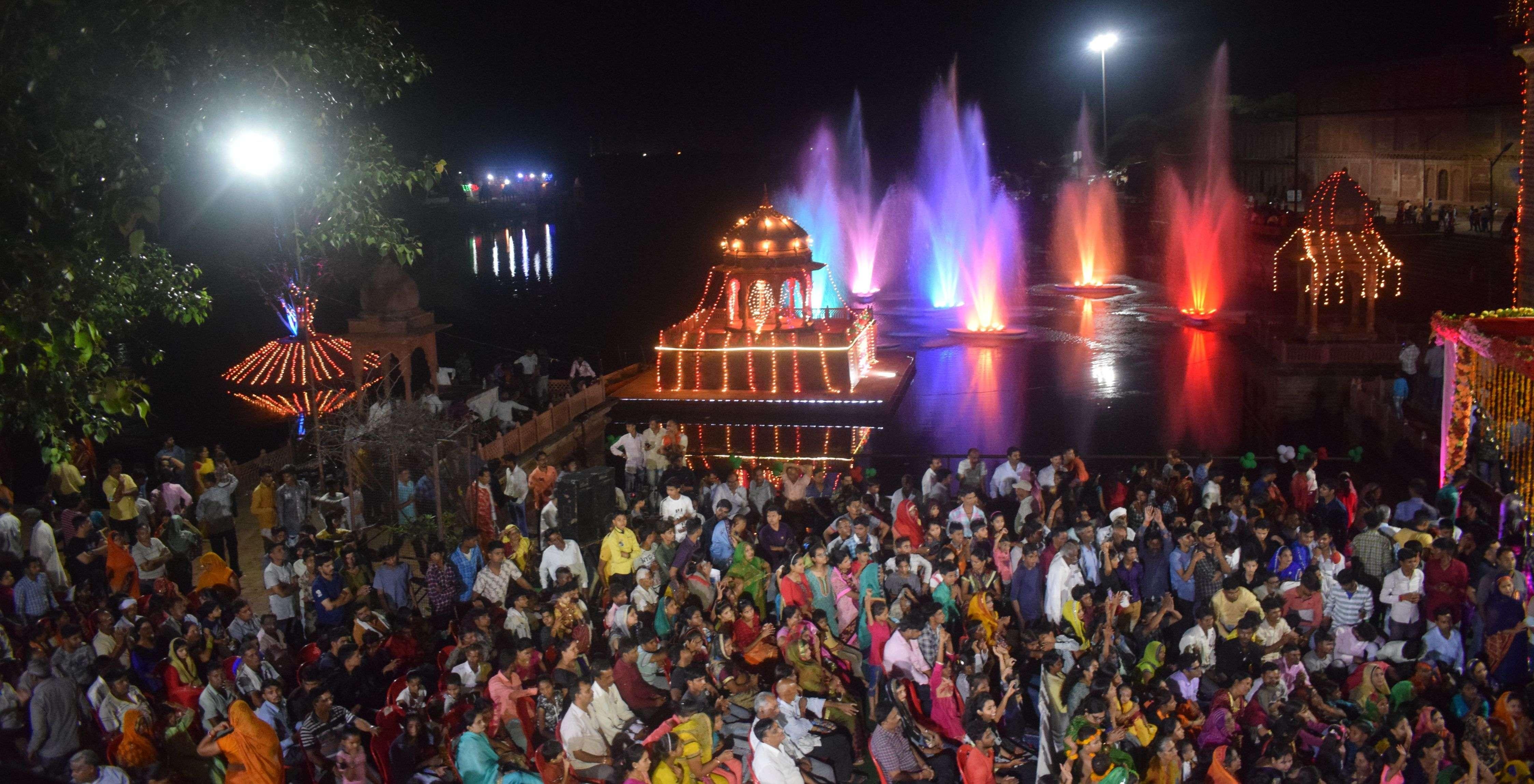Tirtharaj Machkund illuminated with colored lights