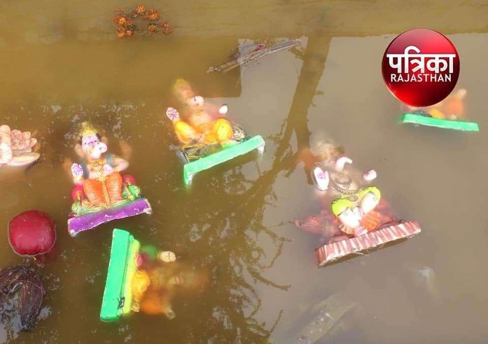 Load Ganesha Statue Dishonoured In Pond