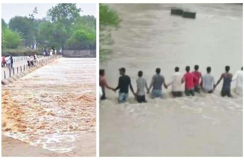 बरसाती नाले में बहे युवक को बचाने के गांव के लोगों ने मिलकर बनाई दीवार, वायरल हुआ विडियो