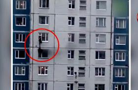 Video: बिल्डिंग से निकल रहा था धुआं, अजनबी लड़के ने ऐसे बचाई लड़की की जान
