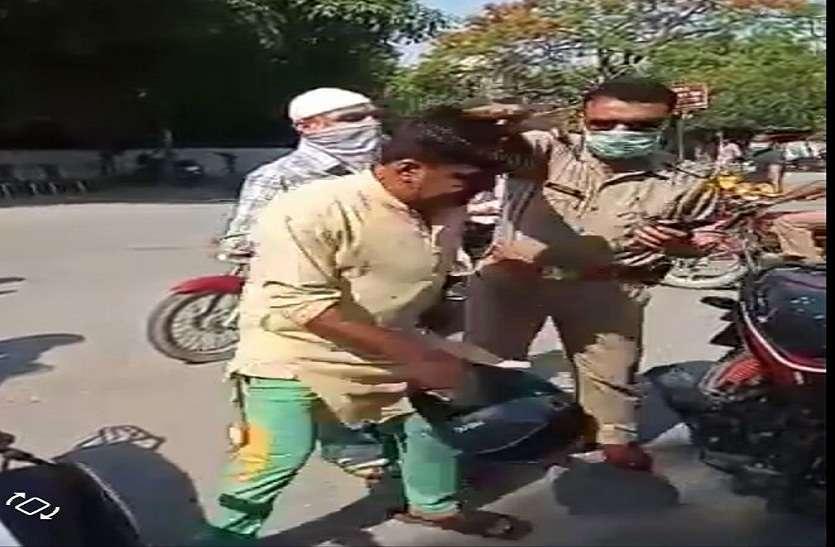 वाहन चेकिंग के दौरान पिता-पुत्र ने किया ड्रामा, हेलमेट सिर में मारा