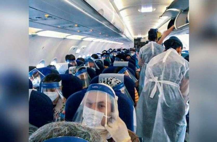 CORONA ALERT : विमान में कोई यात्री कोरोना पॉजिटिव मिले तो ये सावधानियां बरतें