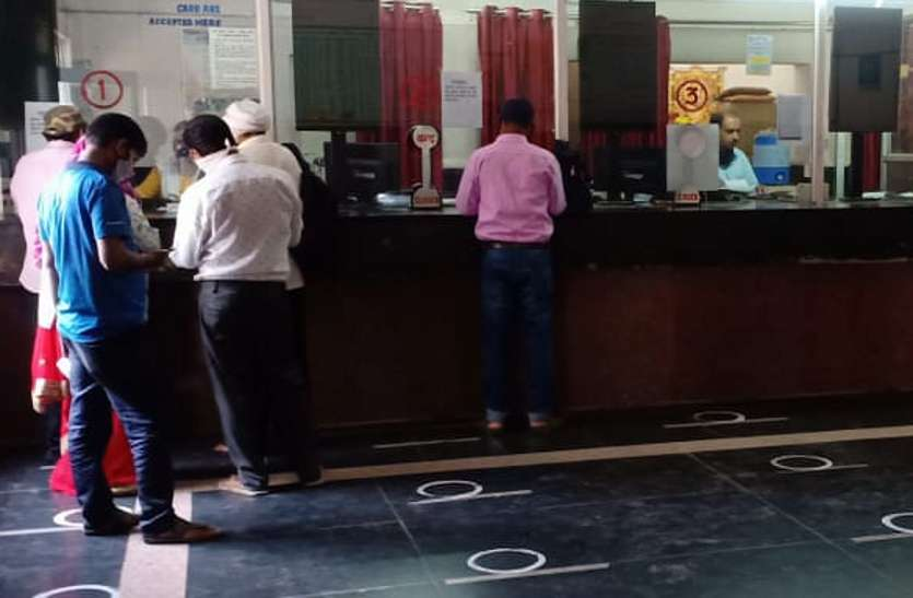 Passengers booking tickets at the reservation counter.