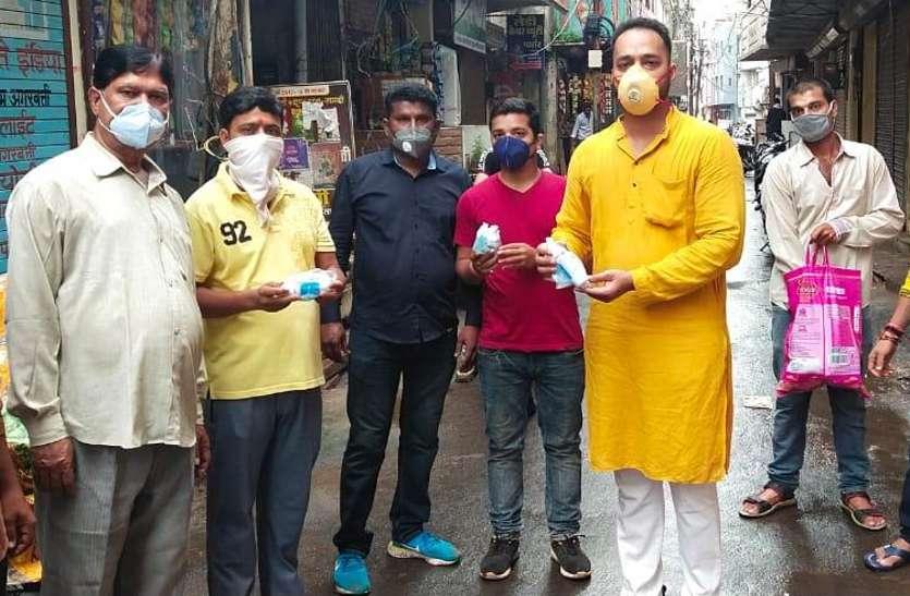 Youth distributing sanitizers.