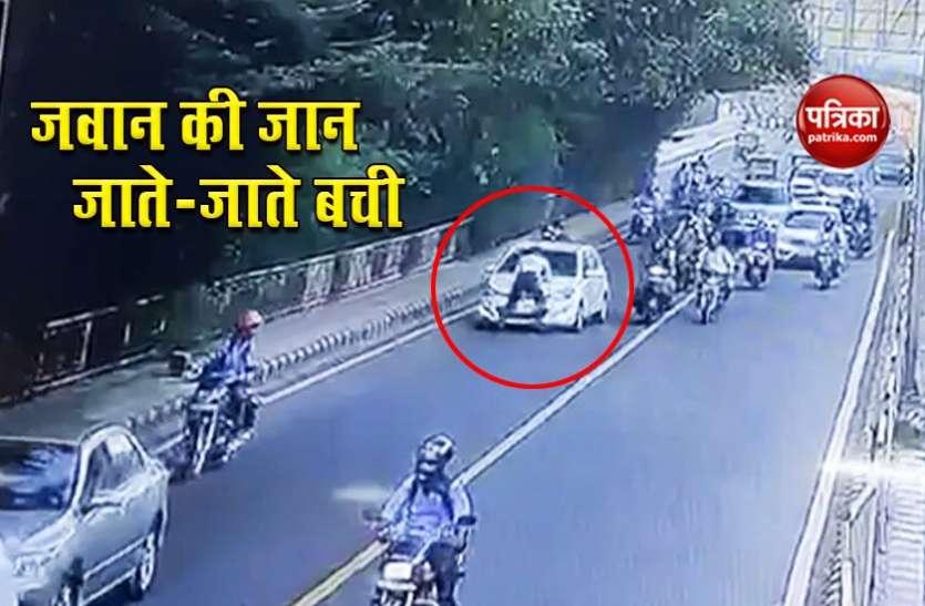 दिल्ली ट्रैफिक पुलिसकर्मी ने कार के बोनट पर कूद बचाई जान, 2 गिरफ्तार, घटना CCTV में कैद