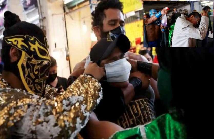 कोरोना के खिलाफ जंग में उतरे रेसलर, लोगों को पकड़कर पहना रहे है मास्क