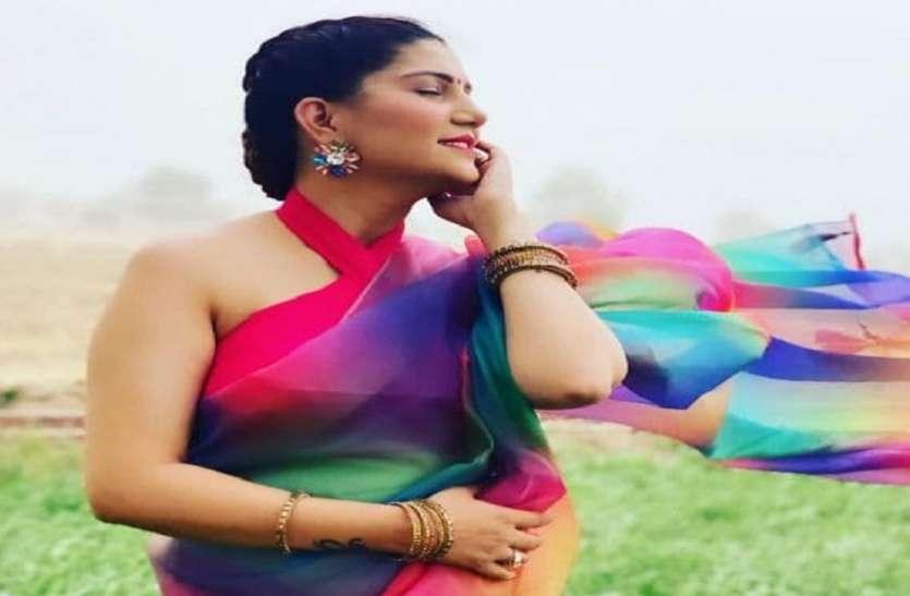 Sapna Choudhary looks stunning as she wearing multi colour saree