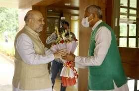 Gujarat: केन्द्रीय गृह मंत्री अमित शाह ने गुजरात के राज्यपाल से की मुलाकात