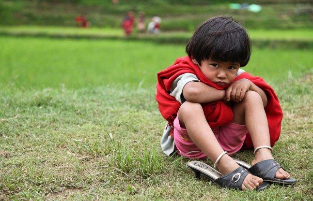 Little indian girl watching Kafal