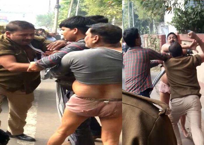 सामने आई यूपी पुलिस की शर्मनाक तस्वीर, सड़क पर जमकर चले लात-घूसे