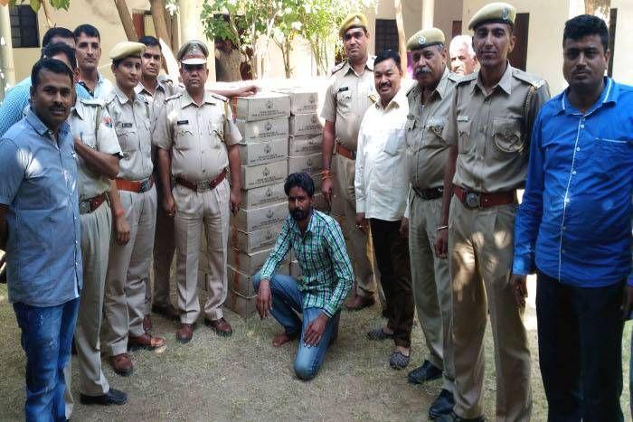 पशु चारे में छिपी 6 लाख की देसी शराब जब्त, चालक गिरफ्तार